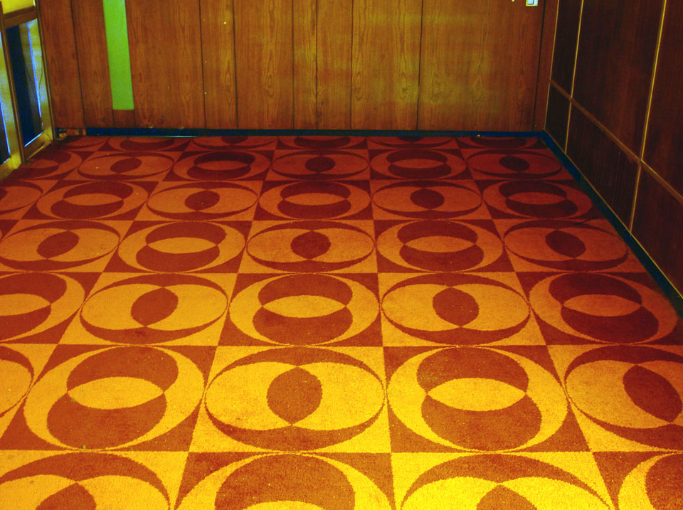 Some funky carpet tiles still in evidence.