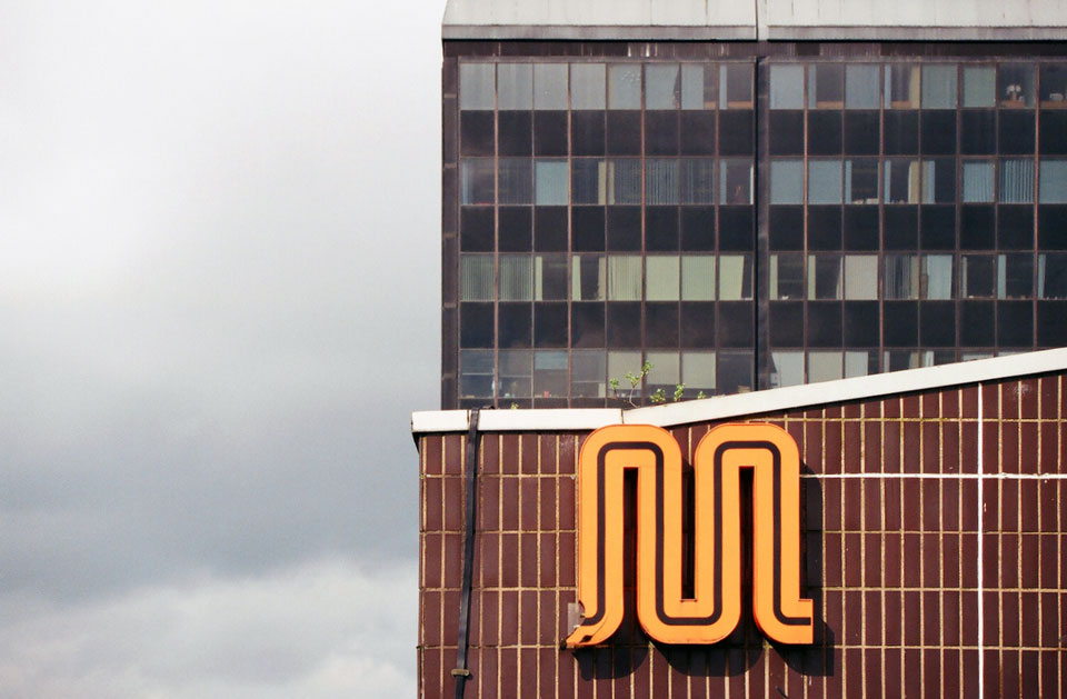 'M'. Former GMPTE logo at head of car park stair core.