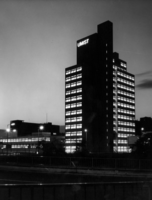 UMIST sign glows at head of tower.